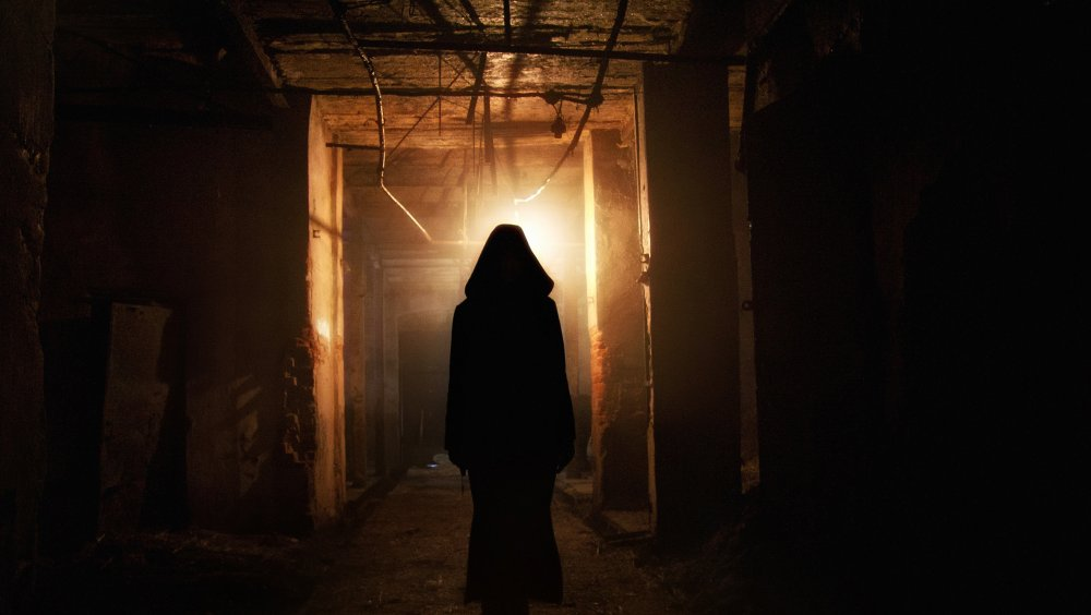 An image of a silhouette in a haunted house like setting