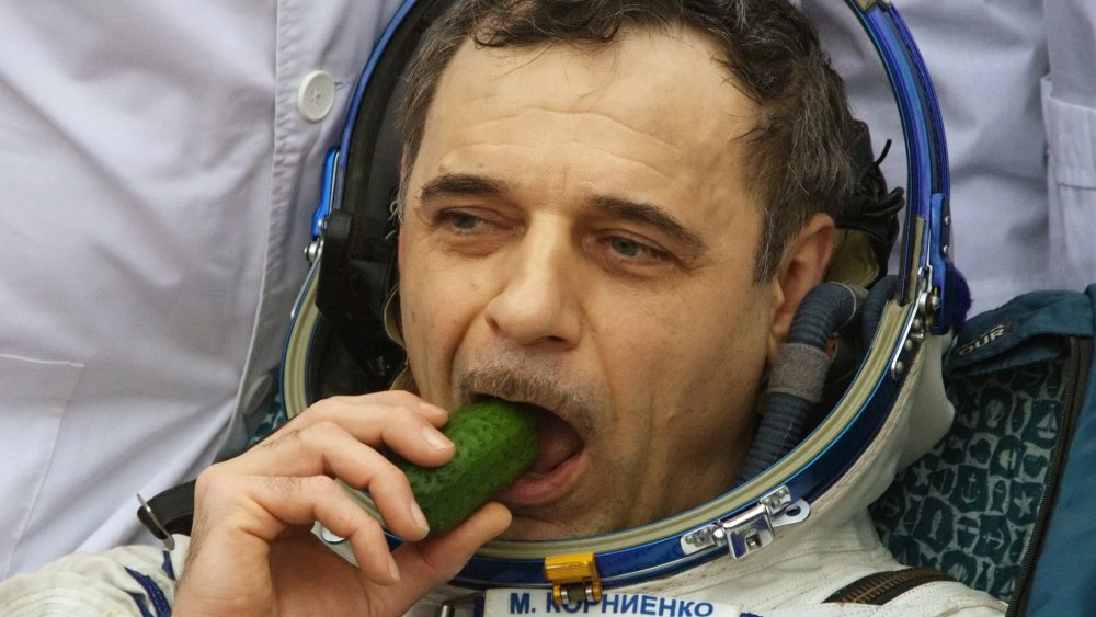 Cosmonaut eating a cucumber