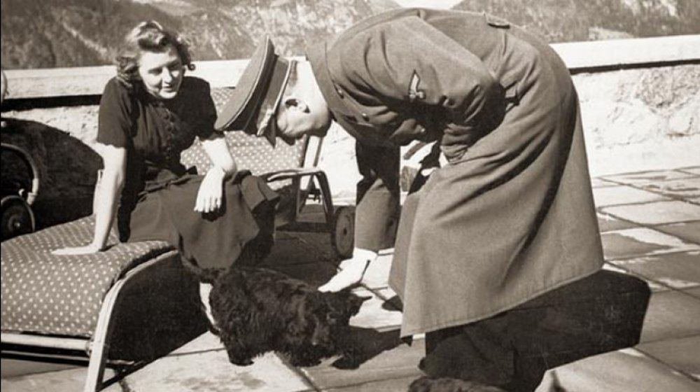 Hitler and Eva Braun with dogs