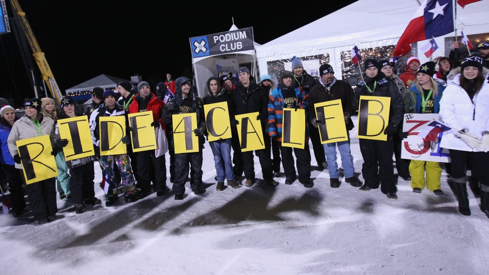 In the wake of Caleb Moore's death during Winter X-Games 2013 Aspen, friends and family support Colten Moore during the snowmobile freestyle finals at Winter X-Games 2014 Aspen at Buttermilk Mountain on January 23, 2014 in Aspen, Colorado.