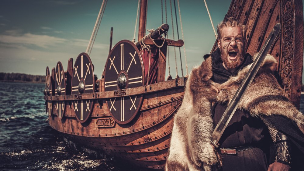 Viking standing in front of longship