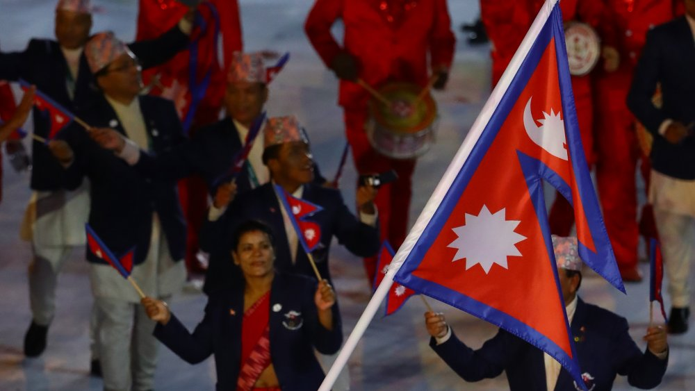A photograph of Nepal's flag against a blue sky.